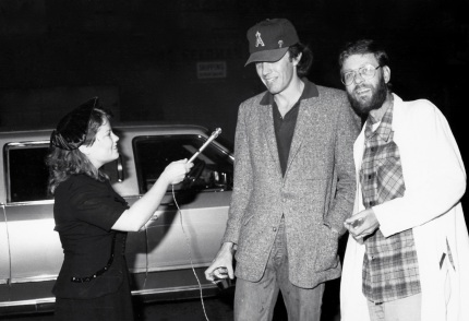 Diane Webb interviews Andy Wilf and John Schroeder upon their arrival at the Golden Turkey Awards in 1981.