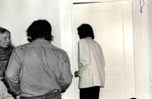 Audience members view Newton's 1980 performance through a door in the Hotel El Dorado on Spring Street.
